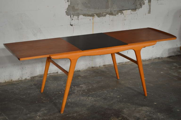 Danish Mid Century Aerodynamic Expanding Coffee Table   From a unique collection of antique and modern coffee and cocktail tables at https://www.1stdibs.com/furniture/tables/coffee-tables-cocktail-tables/
