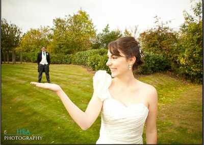 Image from http://www.wedbits.com/wp-content/uploads/2012/01/bride-with-groom-in-her-hand.jpg.