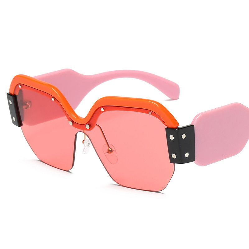 6724ad76a1e9 Rock with style with these oversized semi-rimless sunglasses. Feature  brightly colored lenses