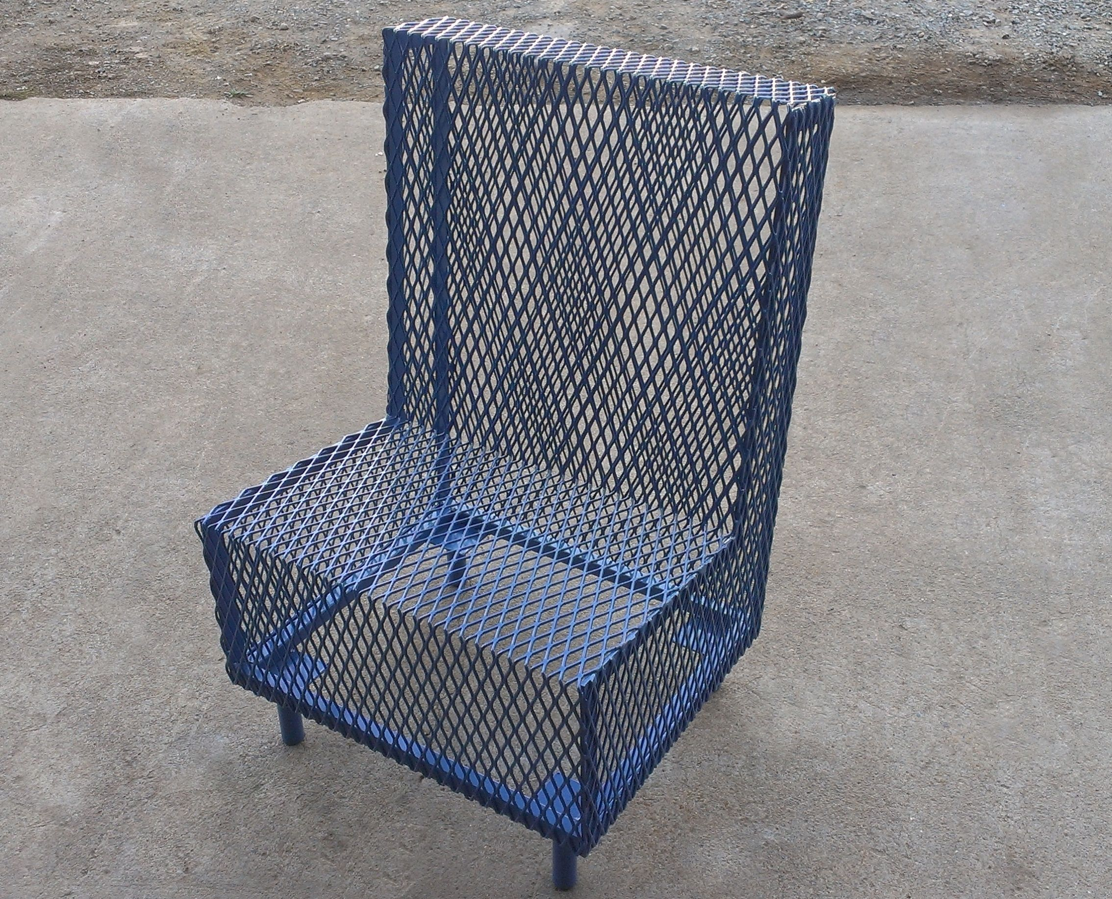 A perforated metal chair powder coated in grecian blue by napa valley custom metal
