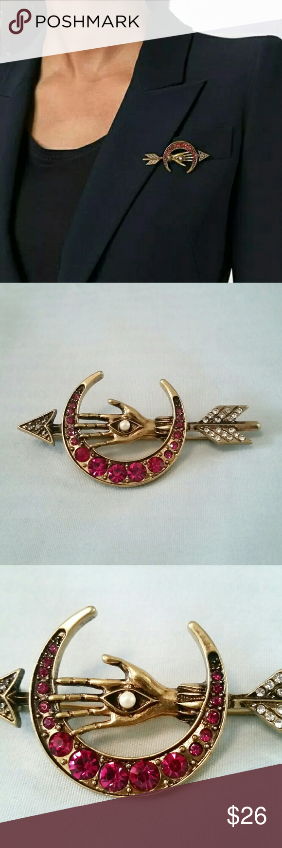 """Mystic moon arrow brooch Mysterious and stunning bronze brooch featuring an arrow behind a magenta-red, gem-encrusted moon, centered by an open hand with evil eye symbol on the palm, and a pearl bead as the pupil. Clear gems on the feather end of the arrow. Striking piece that gives cool, witchy gypsy boho vibes.  2.5"""" by 1.25"""" 2"""" clasp on back  See closet for matching necklace! Wild Rose Boutique  Jewelry Brooches"""