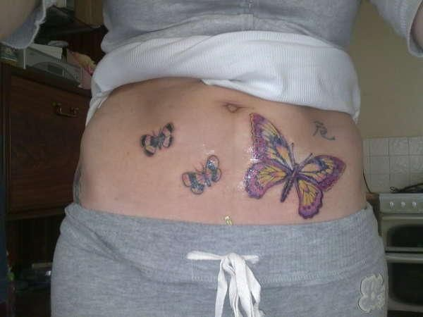 aff6aed8371fa butterflies on stomach tattoo 25 Dandy Stomach Tattoos For Women ...