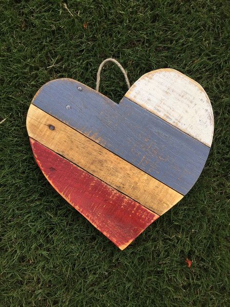 Don't be blue! This reclaimed wood heart packs a big punch. Measuring approximately 1 ft by 1ft, it is perfect for displaying just about anywhere! This heart