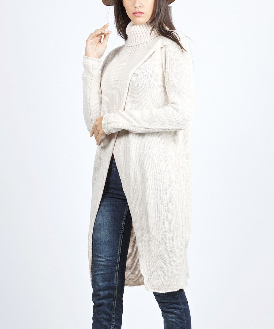 f22c5a5eb7 Another great find on  zulily! Scarlett Cream Tulip-Front Turtleneck Sweater  Tunic by Scarlett  zulilyfinds...nice for nursing