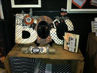 Cute Halloween display for the store. show off new papers and embellishments