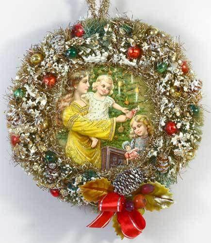 Dresden Star Ornaments - Angel Inside Decorated Bottlebrush Wreath, SOLD (http://www.victorianornaments.com/angel-inside-decorated-bottlebrush-wreath/)