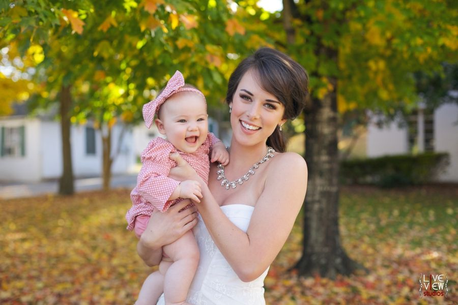 Bride Holding Cute Baby Girl