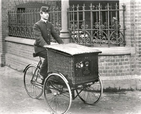 Postman on basket carrier cycle