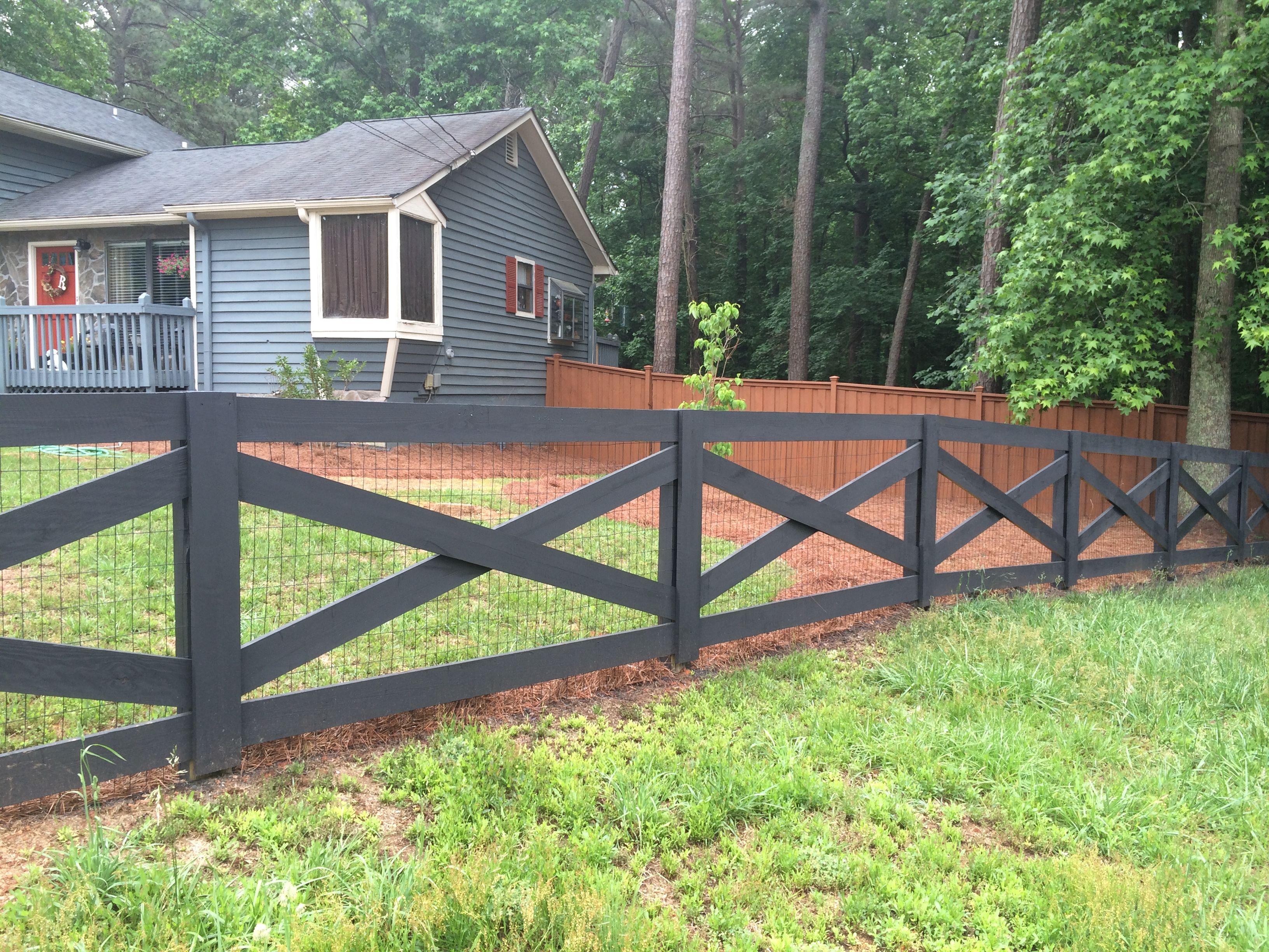crossbuck wood fence painted black wood fences