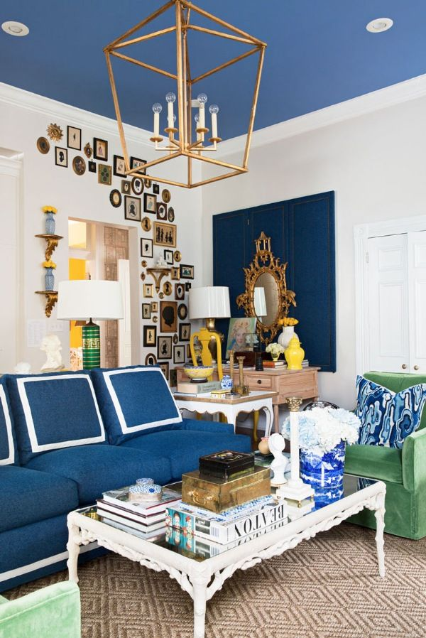 A collection of silhouettes climbs above the desk and around the entryway to create a gallery wall. - Photo: Brittany Ambridge / Design: Lance Jackson & David Ecton
