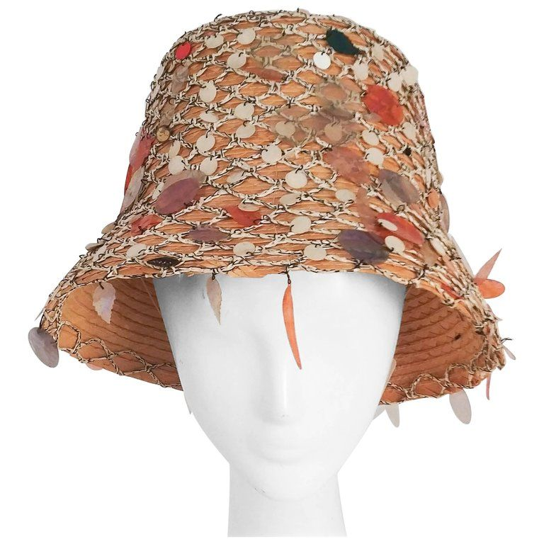 d78b3239ca2a4 For Sale on 1stdibs - 1960s Straw Summer Mermaid Cloche w  Sequins. Fishnet  outer covering. Made in Italy.