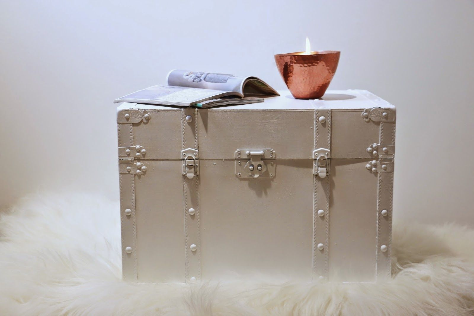 Home inspiration: white painted chest, sheepskin and candle