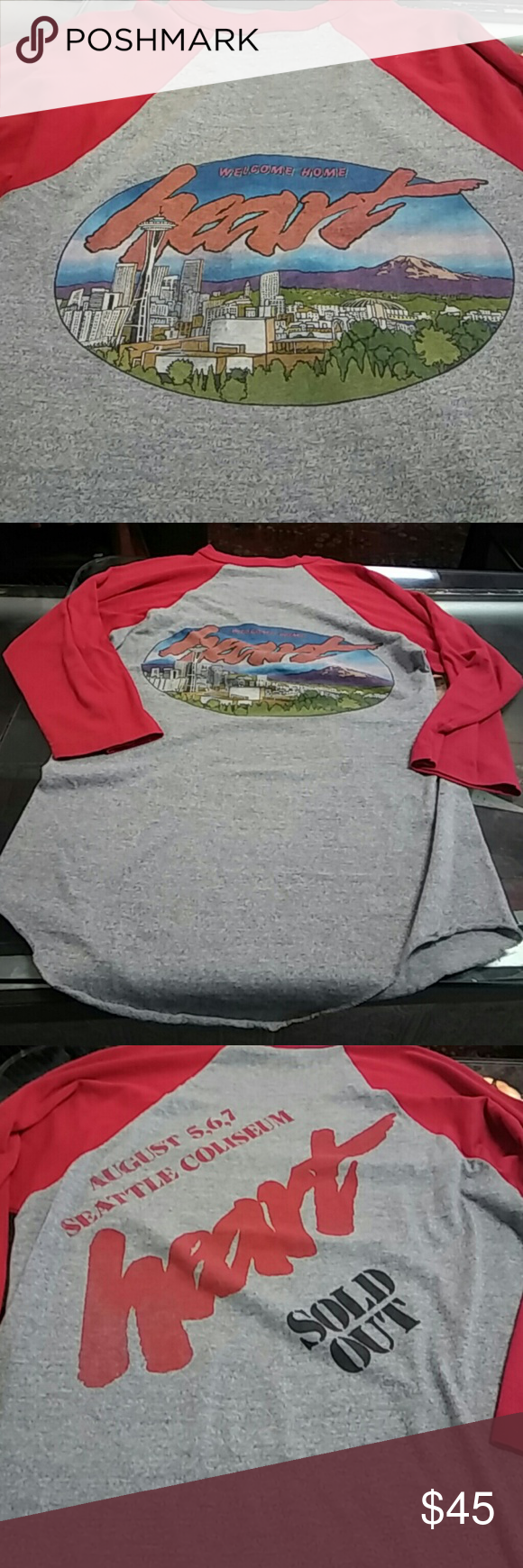 "Vintage ""heart"" band baseball tee Eu vintage condition! Red sleeves grey body. Hearts welcome home shows at seattle coliseum.graphic of seattle wa on front. . idk what year. Made in USA polyester/cotton.medium.unisex Vintage Tops"