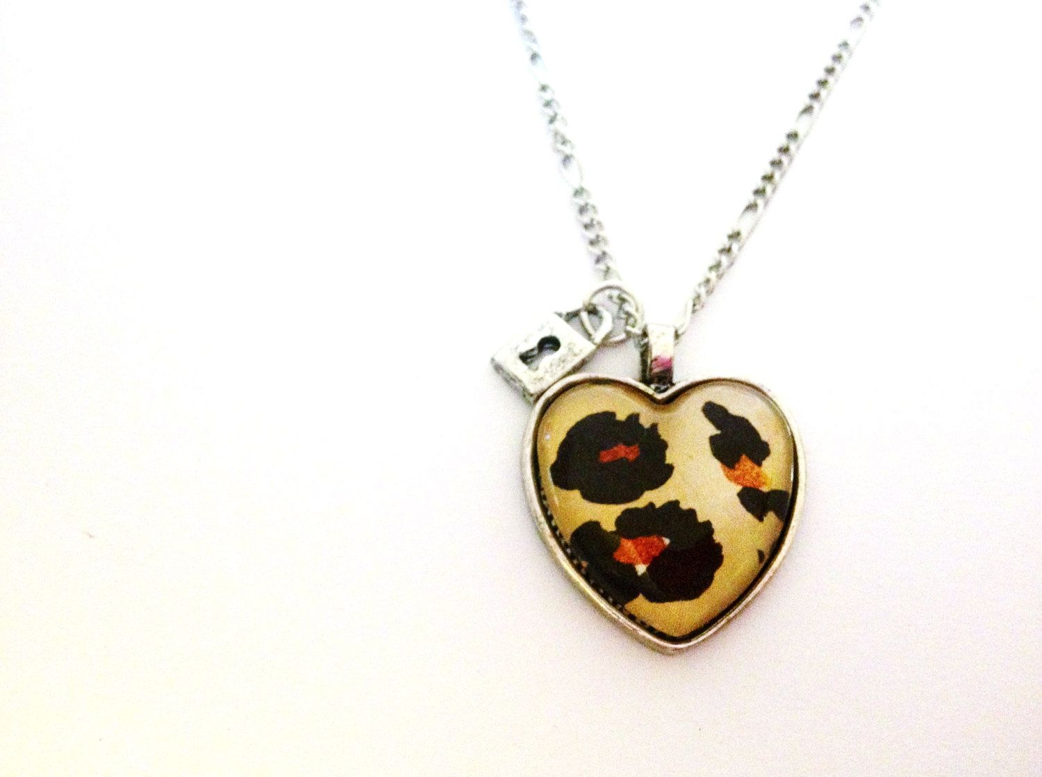 Yellow Black and Brown Cheetah Leopard Print Lock Charm Glass Pendant Necklace, via Etsy.