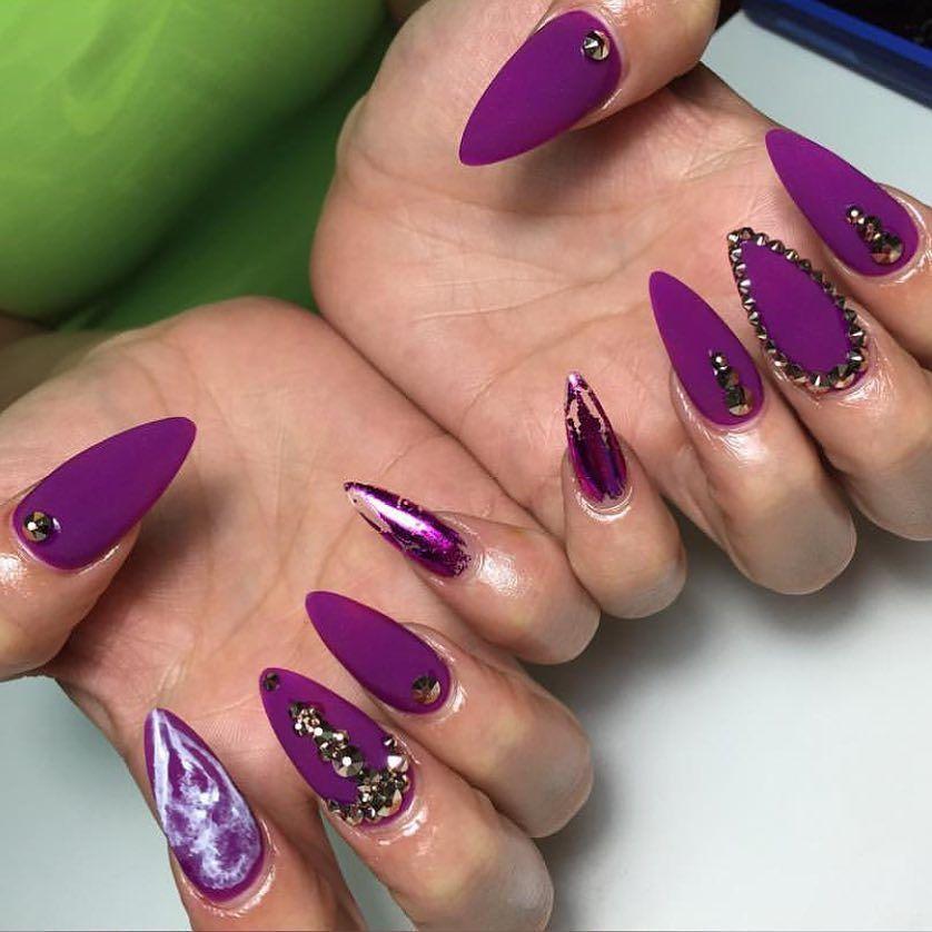 Matte neon purple stiletto nails with foil derail and nail art ...
