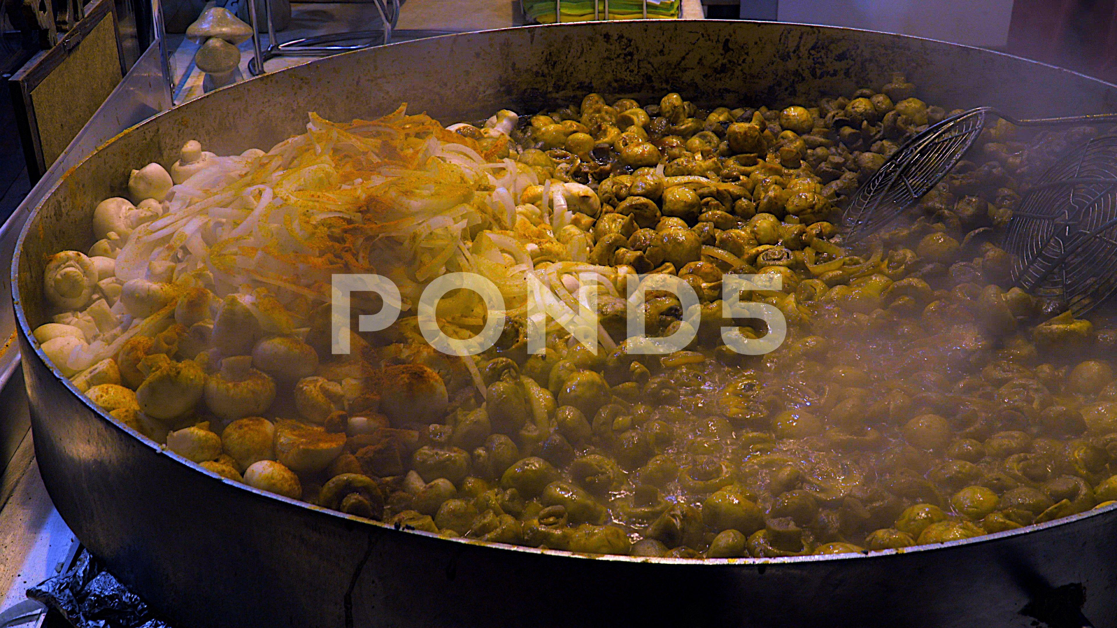 Hot pan with mushrooms and onion and smoke on a christmas