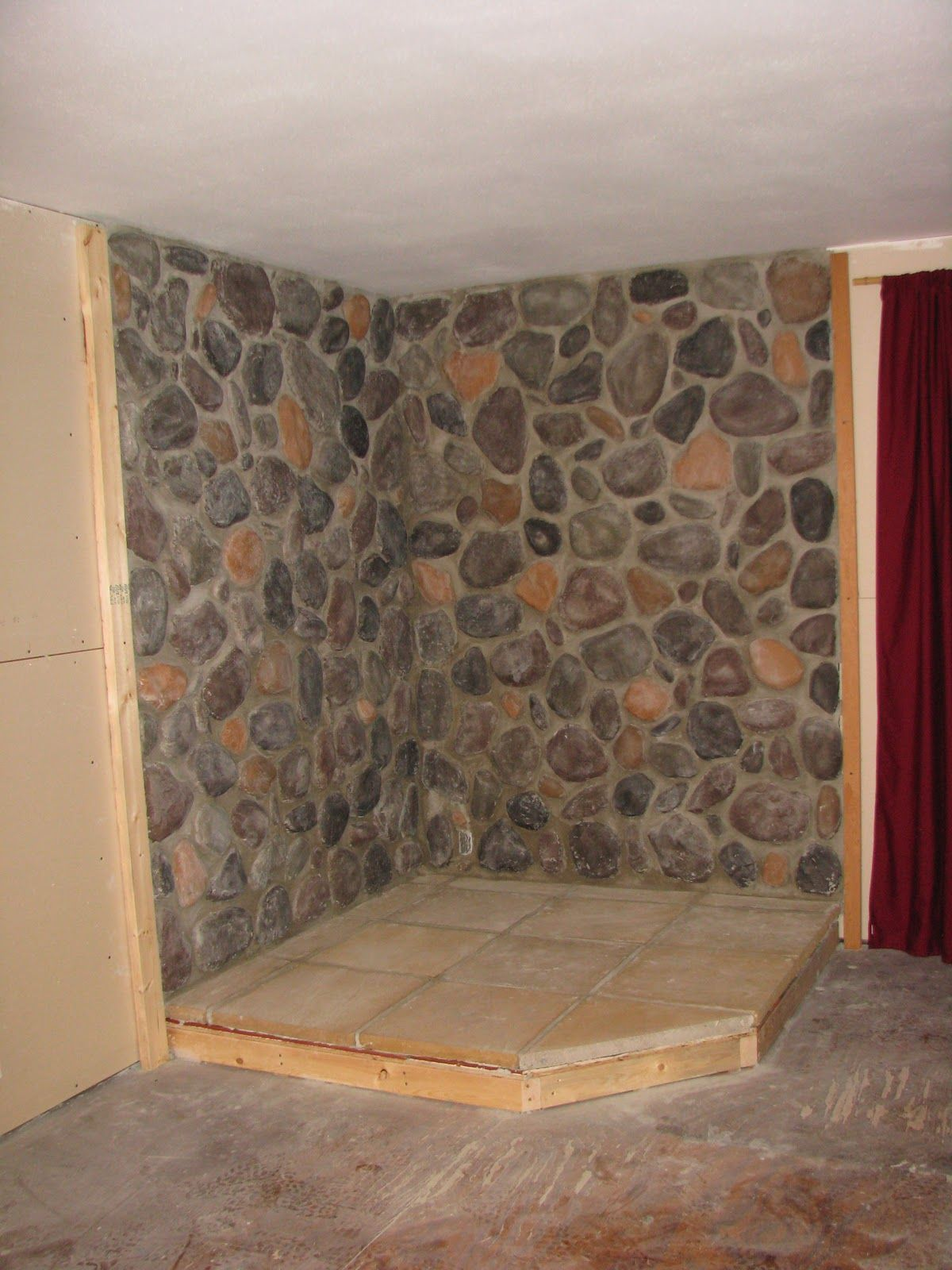 would look better in a log home...river rock wall | Wood And