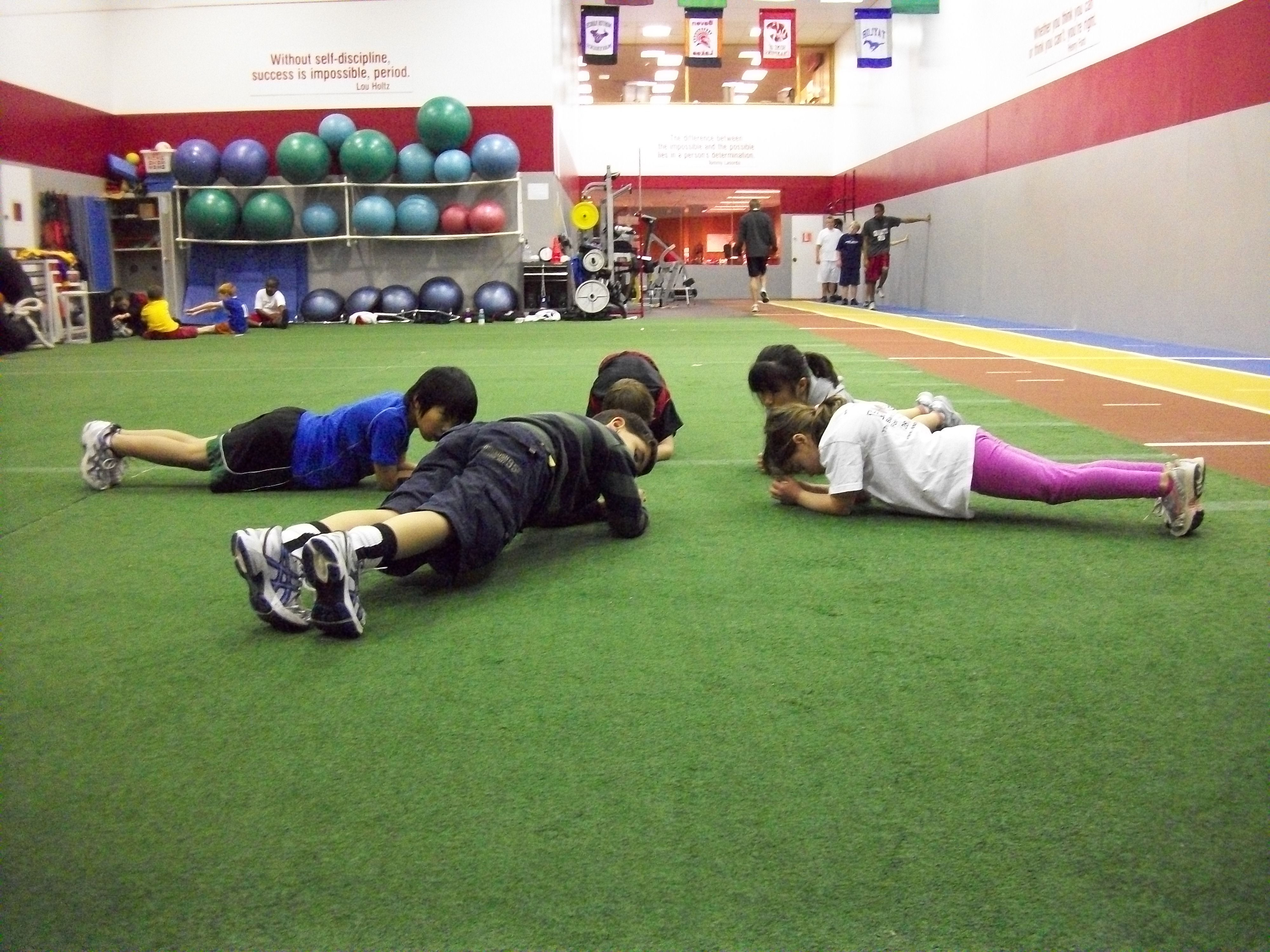 Core exercises with a youth group  | Parisi Athletic