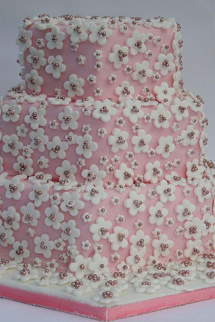 Pink cake with white blossoms by Elizabeth's Cake Emporium