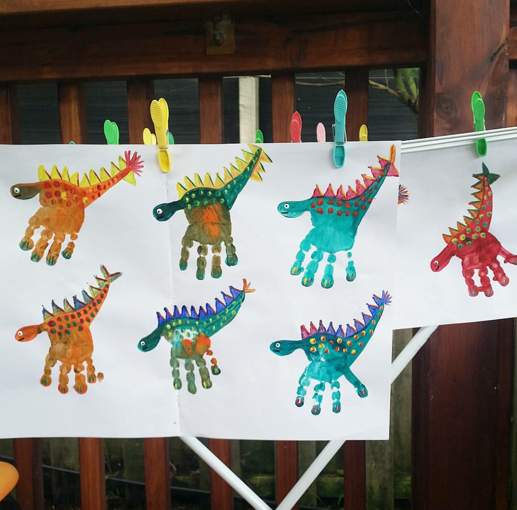 Painting with children - dinosaurs made from handprints -  A creative activity and craft idea for a dinosaur party or for rainy afternoons. Stamp colorful pri - #angeltattoo #Children #cutetattoo #Dinosaurs #foodideas #handprints #ideasforboyfriend #ideasposter #inspirationaltattoo #painting #projectideas #wolftattoo