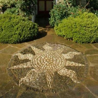 Como hacer jardines con piedras dise o de interiores for Mosaicos para jardin