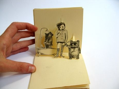pop-up books : Ana Botezatu - click to her site...nice photos...use of tabs for books