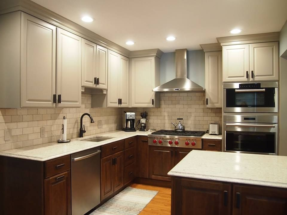 Two tone kitchen. The best of both worlds, white cabinets on top, wood cabinets on the bottom.