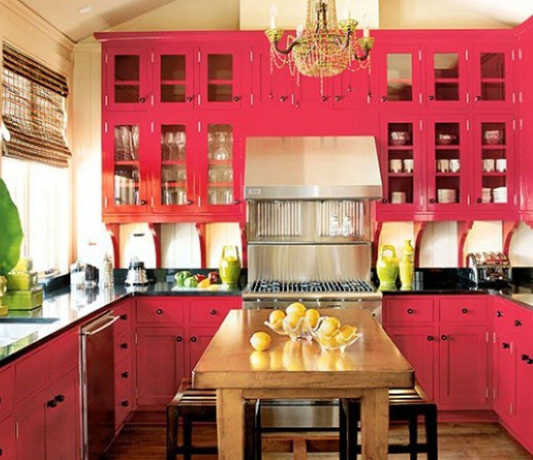 Black granite countertops, pink cabinets and stainless ...