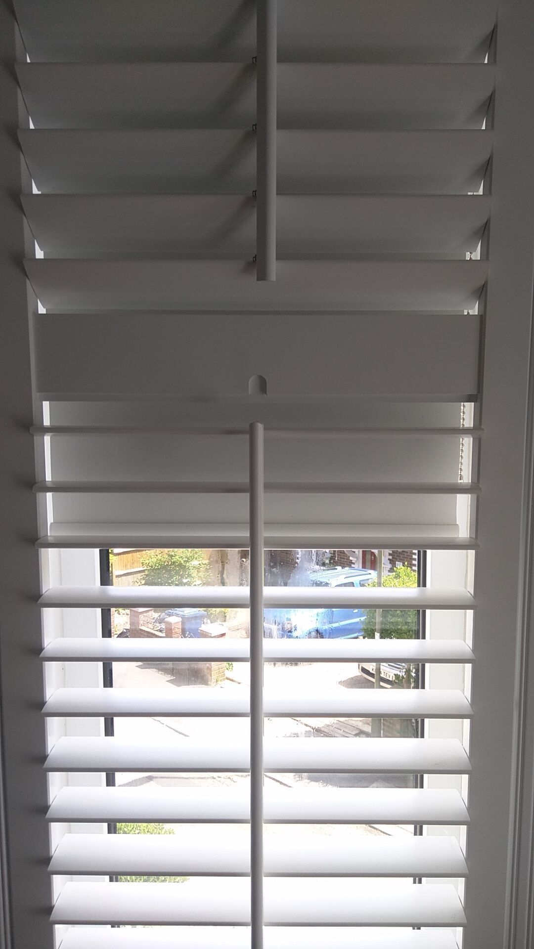 Blackout roller blinds in polar colour which we fitted to bedroom