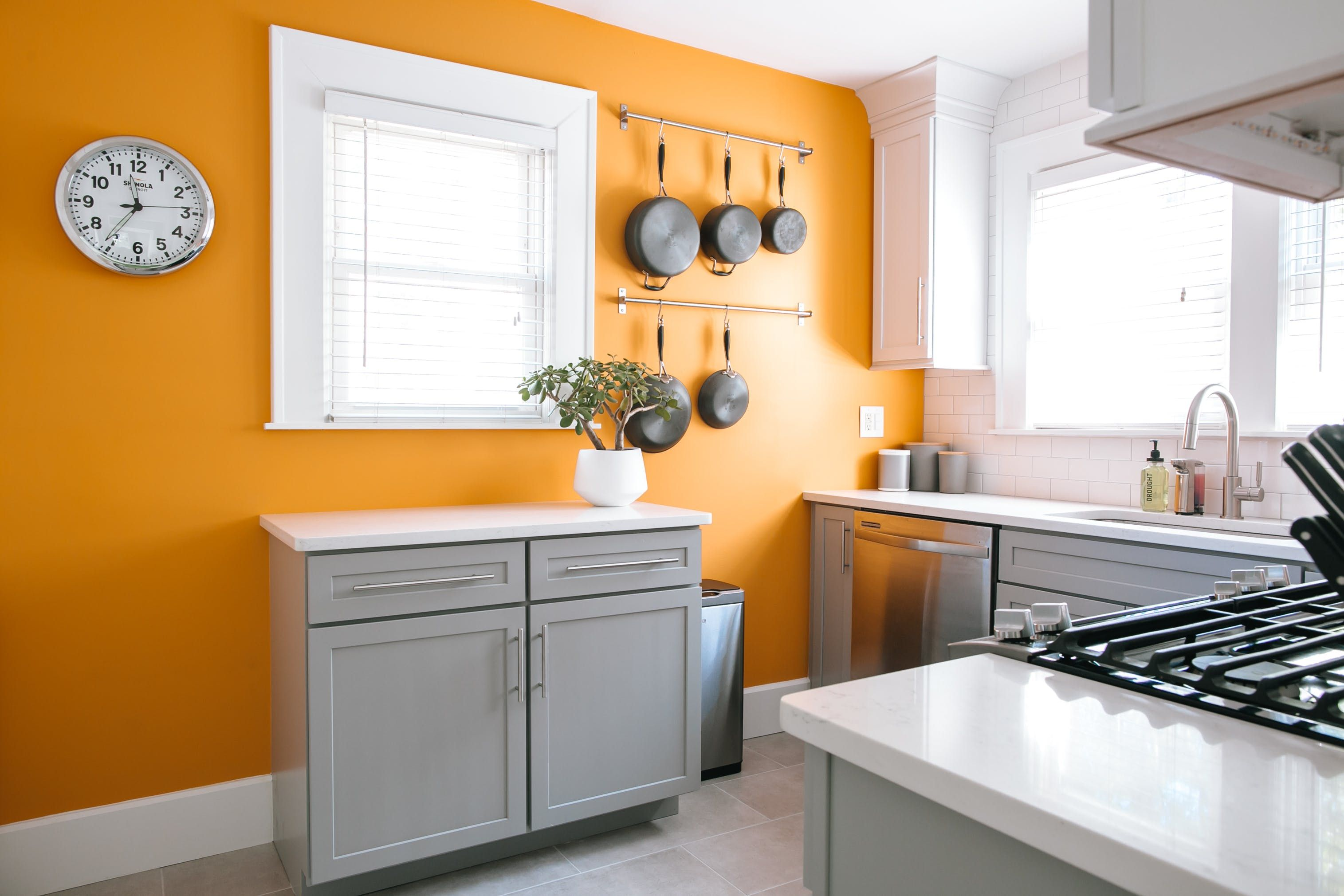 A First Time Home Buyer S Colorful Retro Reno Accent Wall In Kitchen Orange Kitchen Walls Budget Kitchen Remodel