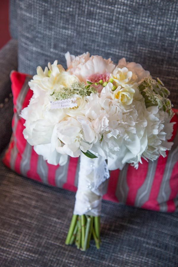 Small white and pink flower bouquet. Tent Wedding on Boston Harbor - BKB & CO. | Boston Wedding Photography and Video Studio