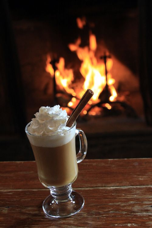 Curl up by the fire at the Ski Tip Lodge with a hot drink ...