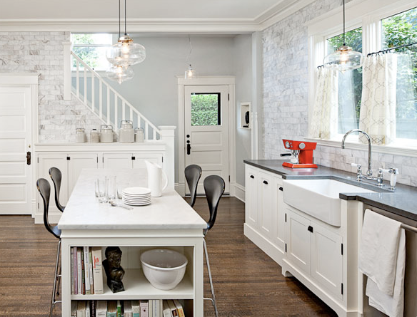 perefection. dark floors & tops. white cabinets. love that POP of red!