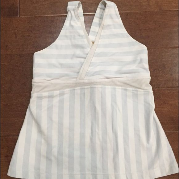 Light blue/gray And white Stripe Tank Reposh. Posher listed as size 8 but it's clearly a size 10. Realized too late to contest the purchase. This is exactly what I paid so this PRICE IS FIRM. Preworn by previous Posher but great condition!! Check closet for other Lululemon items! lululemon athletica Tops