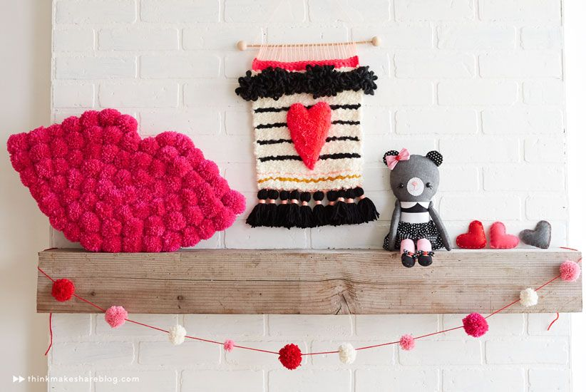 heart weaving -- love the way the fringe is tied into tassels at the bottom. and the heart, obv. :)