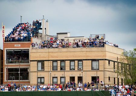 see a cubs game from one if the rooftopswith my bestie
