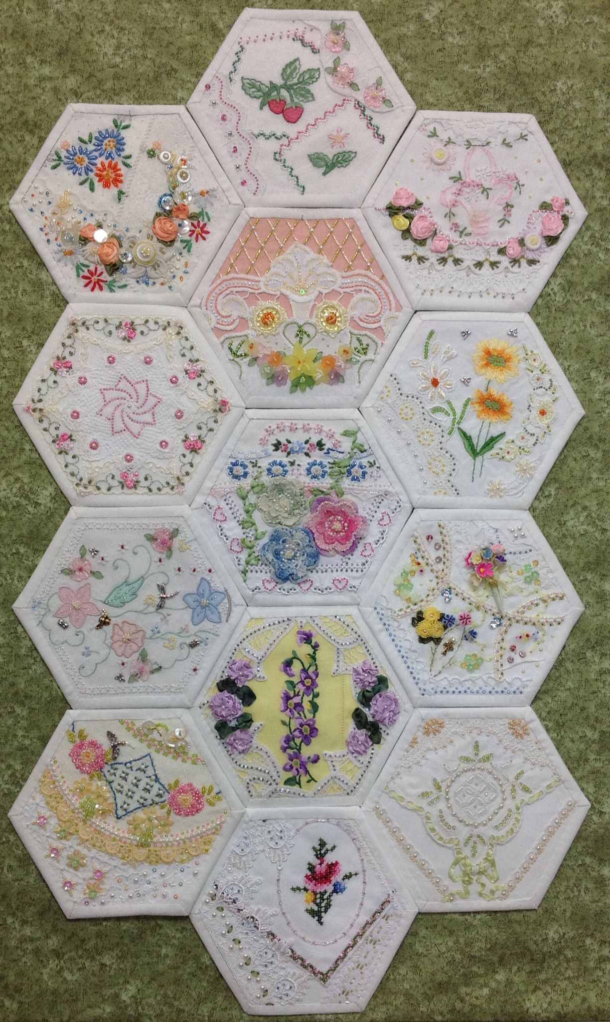 13 of Rhonda Dort s Crazy Quilt Hexagons. Great idea  oversized hexies  could be cut from vintage linens that have damage elsewhere in the piece! 8d2c1d6ae9f1