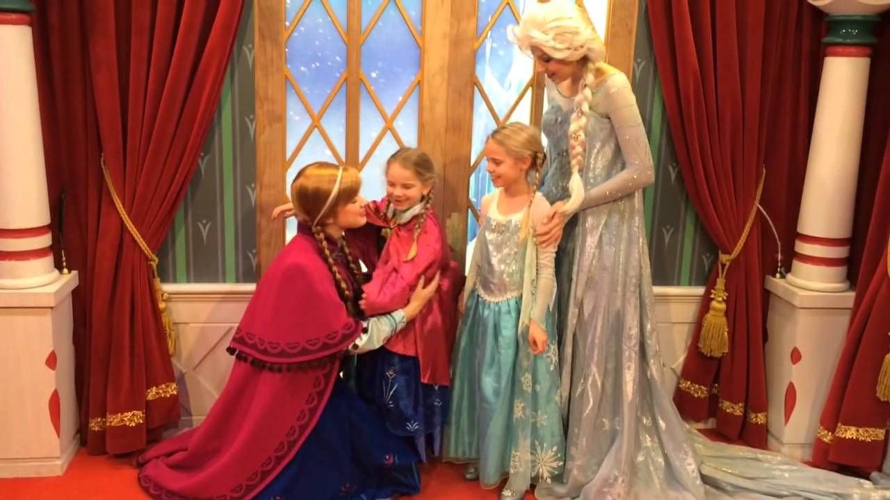 The Sisters From Frozen Holding Hands While Embracing One Another