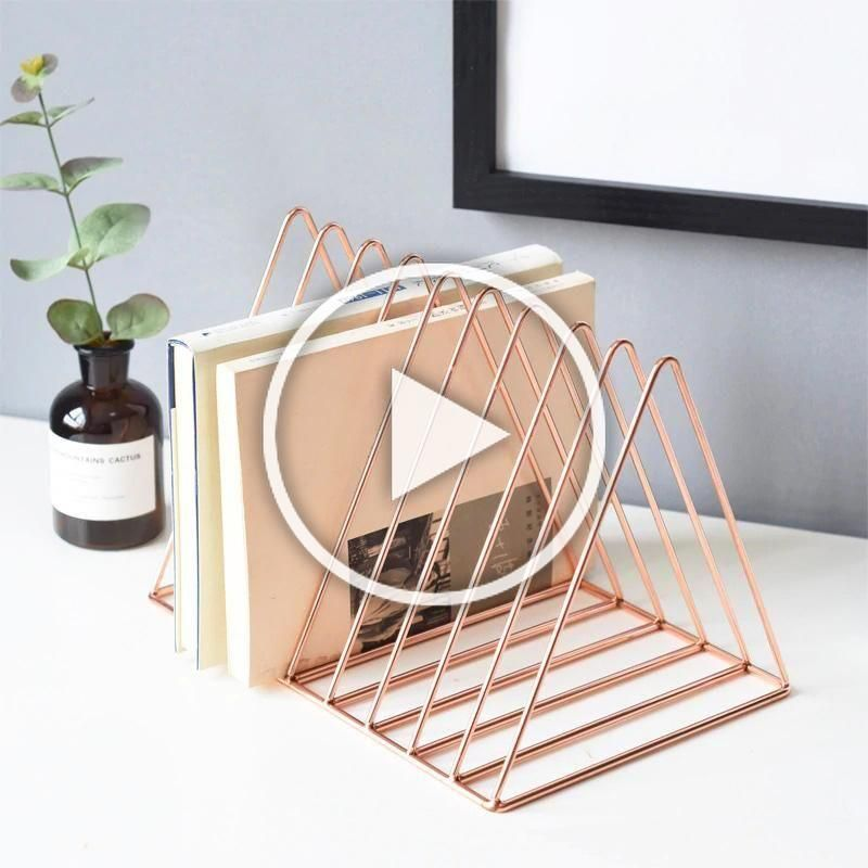 Lux Book Stand features an elegant and minimalistic design. It is a perfect modern solution to organize your books in a stylish way. Choose between rose gold, gold and black color and this gorgeous non-folding iron stand will be yours. Click to see more details. Available now on SALE - at Indeqor. #bookstand #bookholder #bookorganizer #magazineholder #bookrack #homeaccents #homedecor #modernhome #ironstand