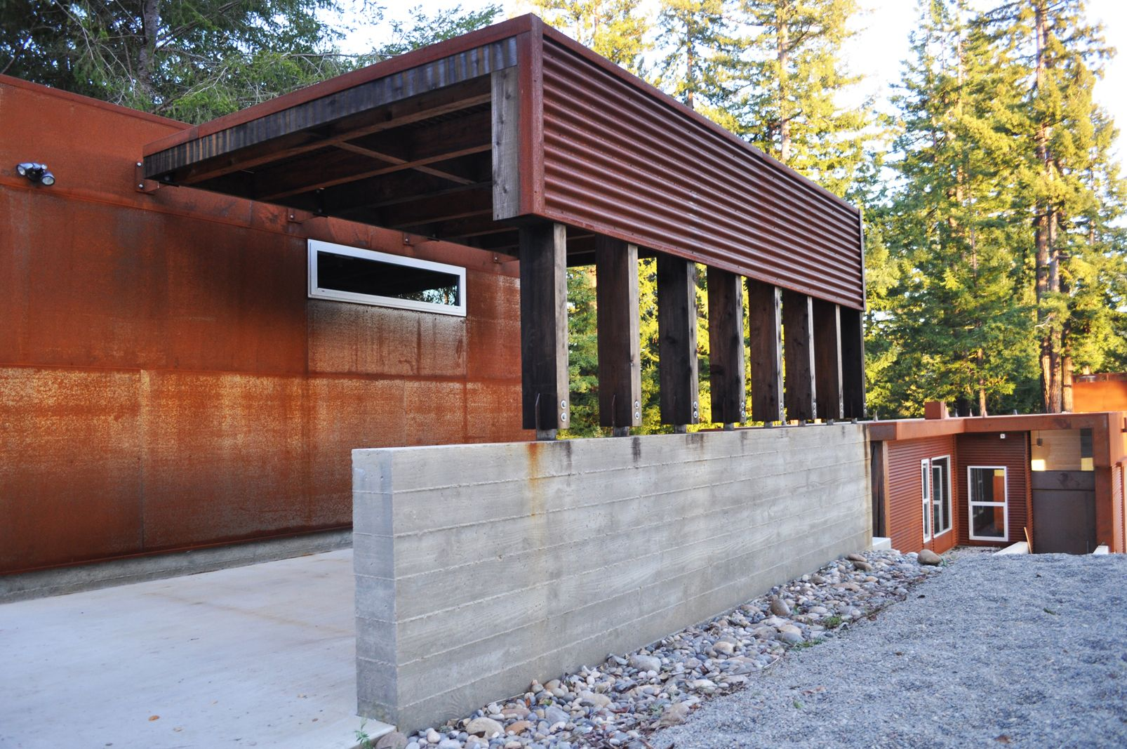 project fern flat designer fuse architects board formed conc try rammed earth posts steel roof