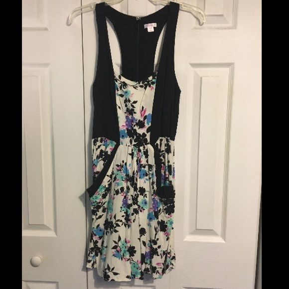 Black and White Multi Floral Dress Black and white dress with blue, mint, pink, and purple flowers. Also has pockets on the front. Very cute! Xhilaration Dresses