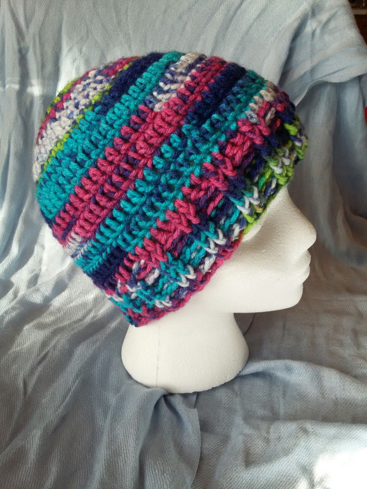 My first ponytail hat/beanie.  Basic pattern found on Ravelry by Jessica King Crochets.  Yarn from Hobby Lobby which I fell in love with.  I have posted several views.  Putting it on differently can give you a whole new look.  I used a stretchy pony tail holder on the top.
