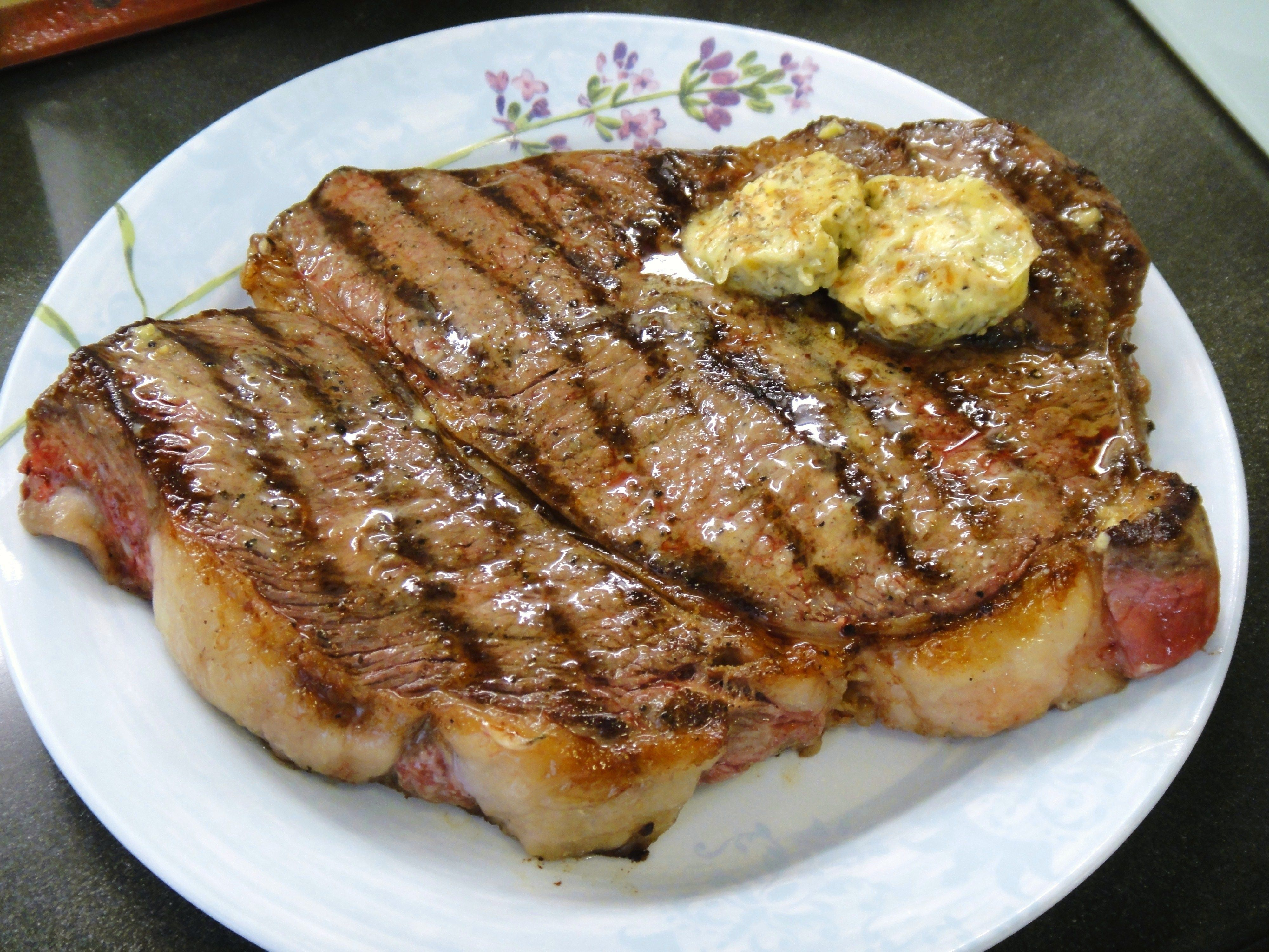 Grilled sirloin steak topped with homemade rosemary thyme
