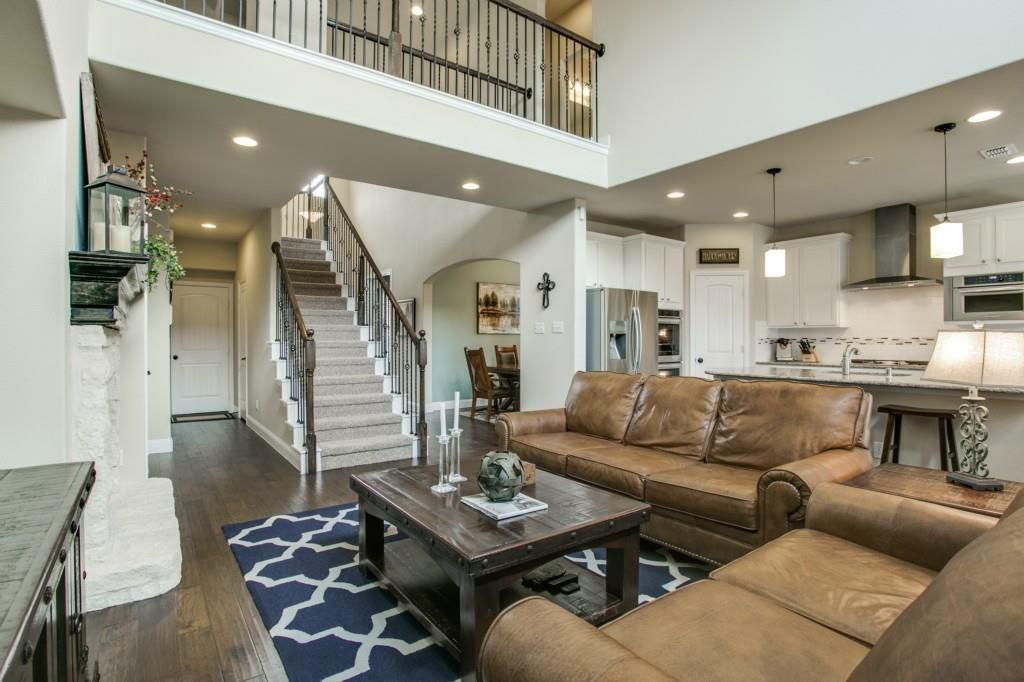 Open Concept First Floor Two Story Living Room With A