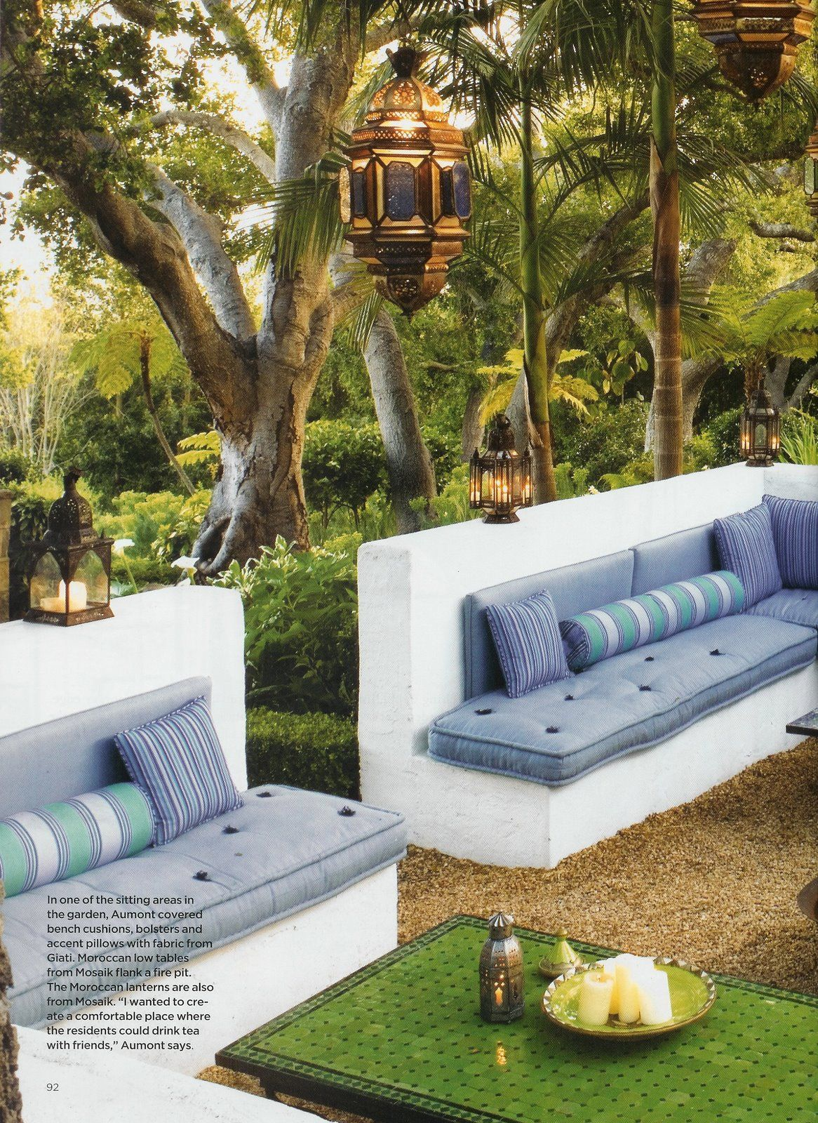 Moroccan inspired outdoor room by Helene Aumont built in seating with a low  wall outdoors with low tables and lanterns lovely cushions such serene vibe
