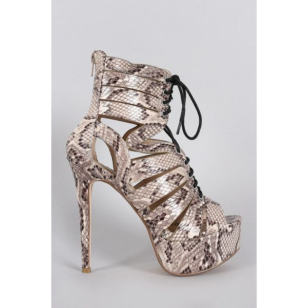 Anne Michelle Python Caged Lace Up Platform Heel found on Polyvore featuring women's fashion, shoes, pumps, snakeskin pumps, peep-toe shoes, peep-toe pumps, lace up pumps and peep toe platform pumps