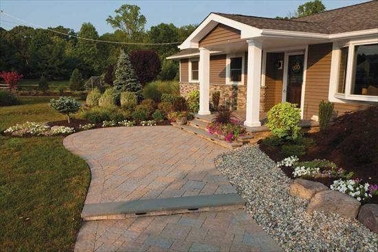 Widening this walkway (and the diagonal pattern) gave this ranch style home a much grander entrance.