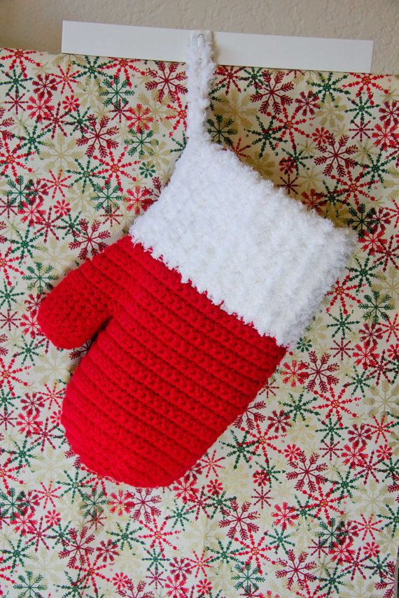 Awesome crocheted Christmas Mitten stocking  https://www.etsy.com/listing/208307691/christmas-mitten-stocking