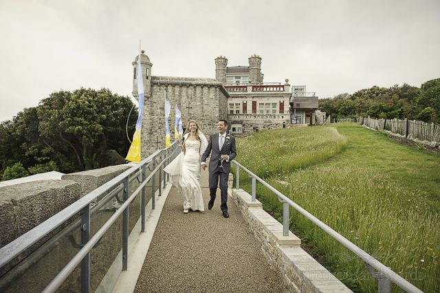 Photograph of bride and groom at Durlston Castle, Swanage by one thousand words wedding photographers www.onethousandwords.co.uk