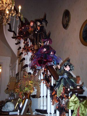 Whimsical witches sliding and flying down the staircase